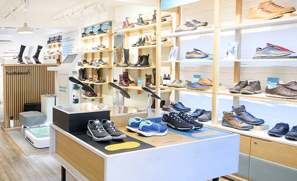 Display of men's and women's shoes in a FootBalance UK Store