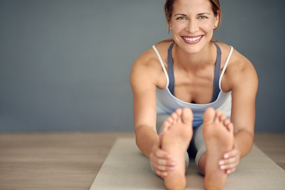 Woman smiling and holding her feet