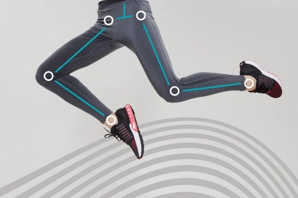 Close-up of legs jumping with lines drawn to show body alignment